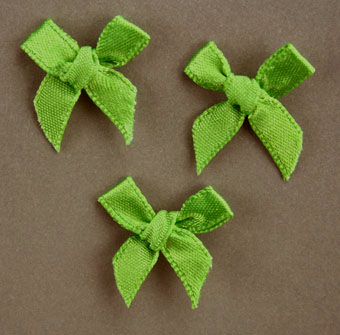 Pack of 100 2cm Bows. Apple Green.