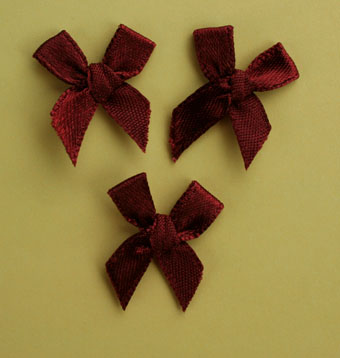 Pack of 100 2cm Bows. Burgundy.