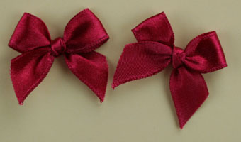 Pack of 50 3cm Bows. Crimson.