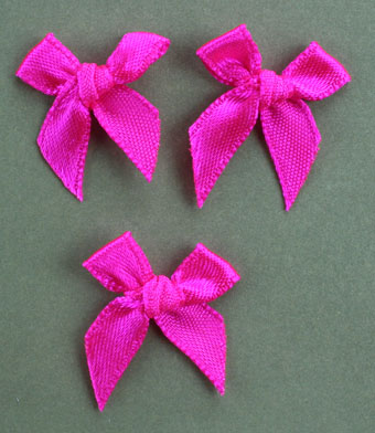 Pack of 100 2cm Bows. Hot Pink.