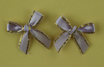 Pack of 100 2cm Bows. Lavender and Gold.