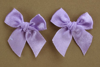 Pack of 50 3cm Bows. Lavender.