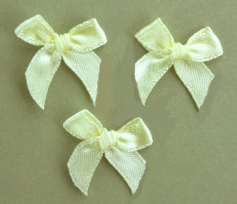 Pack of 100 2cm Bows. Lemon.
