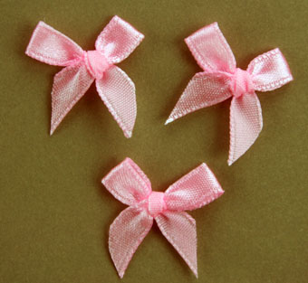 Pack of 100 2cm Bows. Pink.