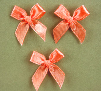 Pack of 100 2cm Bows. Pale Orange.