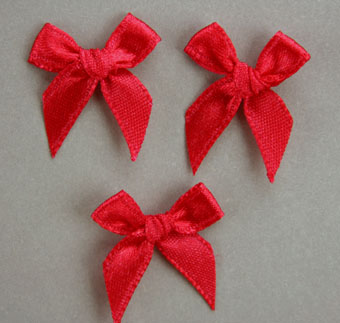 Pack of 100 2cm Bows. Red.