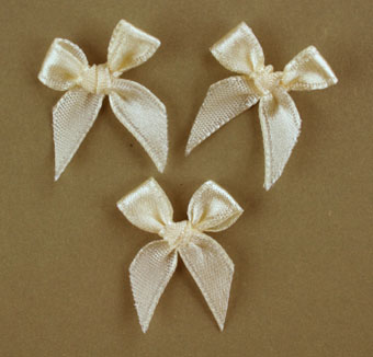 Pack of 100 2cm Bows. Cream.