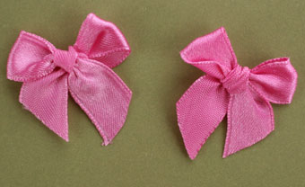 Pack of 50 3cm Bows. Dark Pink.