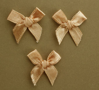 Pack of 100 2cm Bows. Light Brown.