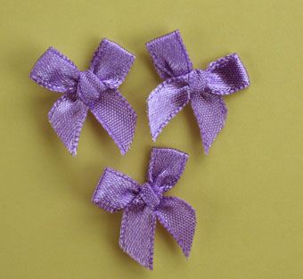Pack of 100 2cm Bows. Lavender.