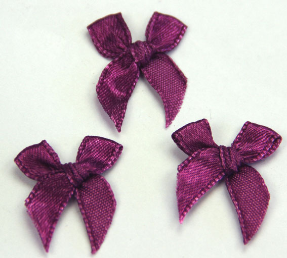Pack of 100 2cm Bows. Plum