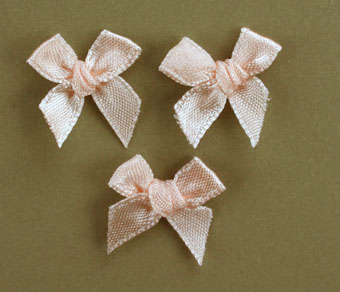 Pack of 100 2cm Bows. Salmon.