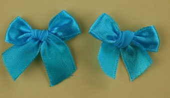 Pack of 50 3cm Bows. Turquoise.