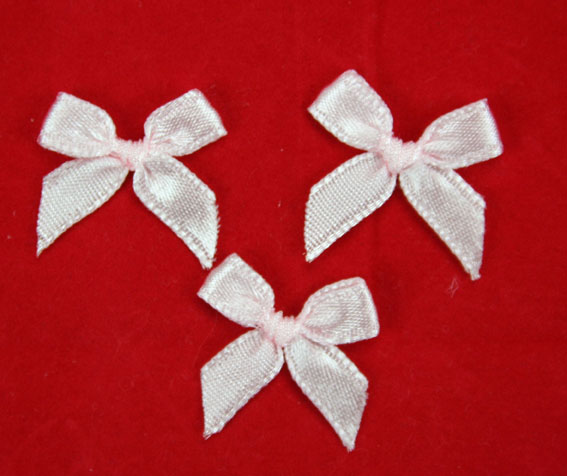 Pack of 100 2cm Bows. Pale Pink.