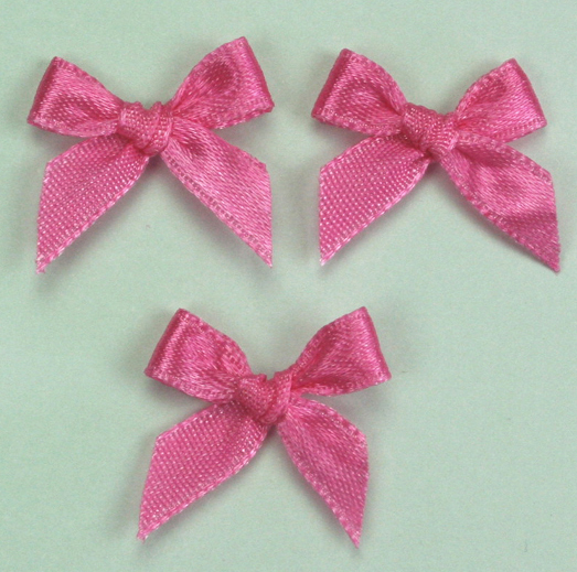 Pack of 100 2cm Bows. Dark Pink